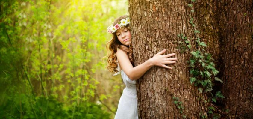 850_400_young-woman-hugging-a-tree_1491499697